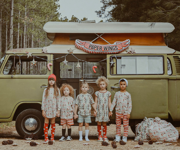 Five children standing in front of van while wearing Paperwings