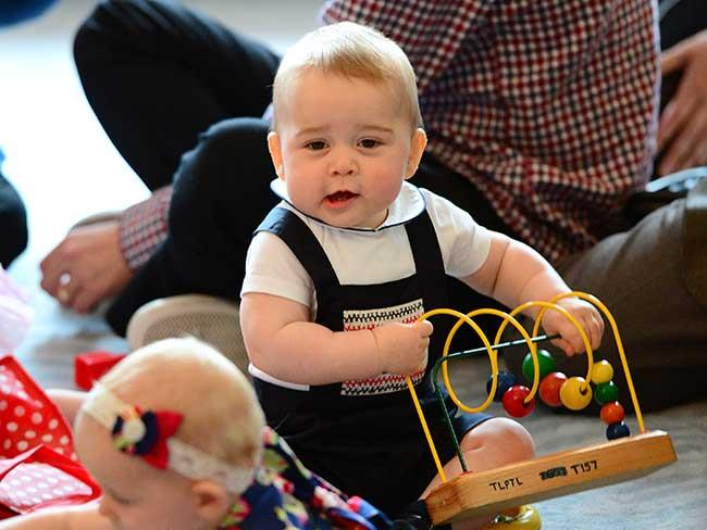 Baby Prince George plays with toy