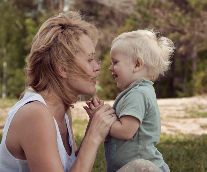 Baby smiling at mum