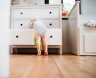 child friendly furniture - small child climbing into drawer