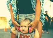 small child wearing headphones enjoying byron bay bluesfest