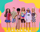 6 diverse Barbie dolls lined up against pink background