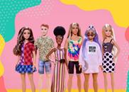 6 diverse Barbie dolls lined up against pink background