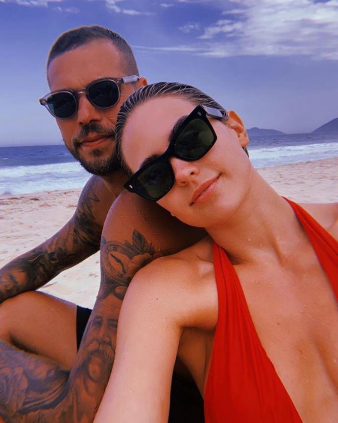 Jesinta and Buddy Franklin on the beach on a sunny day