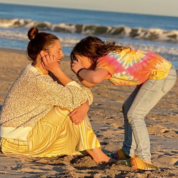 drew barrymore on the beach with daughter Olive