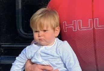 This adorable baby has inherited his famous dad's scowl. Can you guess who it is?