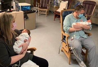 Parents who battled coronavirus finally meet their newborn twins 20 days after their birth